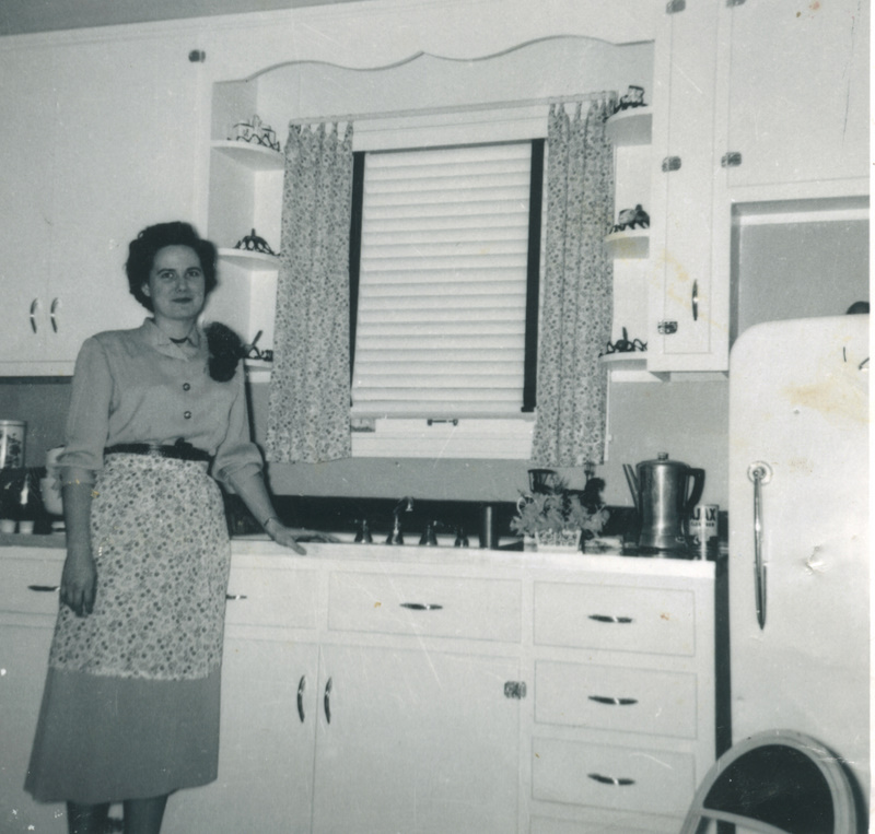 I love this picture of my Mom. Is she a new bride in a new kitchen? Sure looks like it.